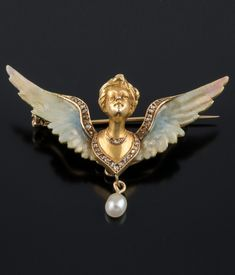 AN ART NOUVEAU GOLD, ENAMEL, DIAMOND AND PEARL BROOCH.