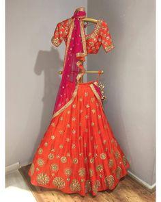Stunning orange chakra lehenga from banjara collection of Mrunalini Rao.Available at ogaan india. 02 August 2017