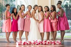 Bridesmaids w/ bouqets on floor. A Pleasantly Pink Ombre Wedding in Florida - Munaluchi Bridal Magazine