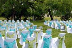 lime green and turquoise wedding | chair covers complete with satin lime green and aqua sashes