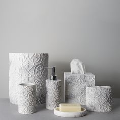 For must-have bath décor, look no further than the Brookline Bath Bundle. This six piece set is carefully crafted in resin and includes one soap dish, tumbler, toothbrush holder, lotion dispenser, tissue cover, and wastebasket. Featuring a white and gray faux marble exterior with an embossed pattern for a textured look and feel, these elegant accessories present a classic luxe aesthetic for your bathroom. The sleek metallic head of the Brookline Lotion Dispenser creates contrast and adds a…