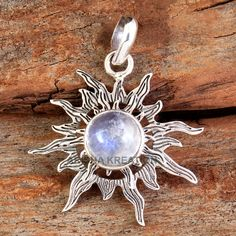 handcrafted sterling silver filigree pendant featuring a lovely iridescent moonstone cabochon. Original design