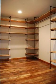 Great shelving - made from pipe!  I need to figure out how to turn my closet into something as amazing as this.  Need space for all of those shoes!! by deirdre