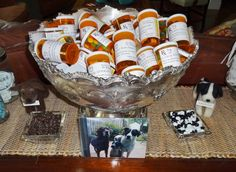 Party favor pill bottles w/ color coded m's for each pet.