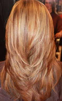 long layers, red, blonde, and golden highlights