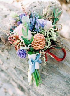 exotic bouquet for destination wedding #bouquet #bride #weddingchicks http://www.weddingchicks.com/2014/03/05/beach-town-wedding/