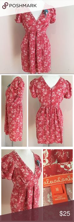 Pink Calico Floral V-neck Dress with Sleeve Detail This dress is darling and so very flattering! Pretty pink color with white floral pattern all over. Puff sleeve with ruching, zipper in back, 100% cotton, knee length. Gently used condition! Size Medium, fits true to size. Francesca's Collections Dresses