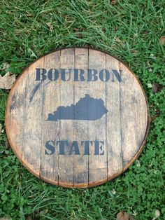 Kentucky bourbon whiskey barrel head  by KyBarrel on Etsy, $50.00  With my Old Kentucky Home on it instead of Bourbon State