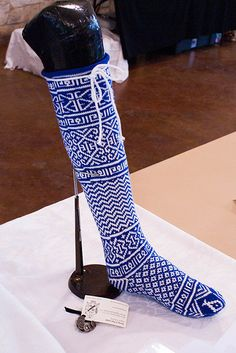 Very beautiful creative Egyptian socks by Elen verch Phellip of Ansteorra, displayed at Candlemas 2013 at her Baronial Arts and Sciences Champion event.