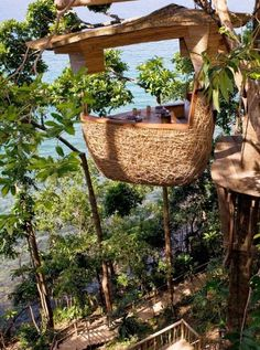 One of the resort's many restaurants is the treetop dining pod, where waiters zipline in Thailand