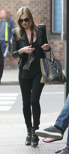A python Balenciaga bag added a touch of colour to an all-black look that combined most of Kate's trademarks: leather, skinny jeans, ankle boots, and big sunglasses!