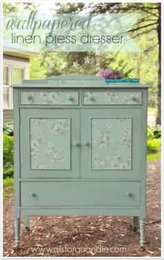 Painted cabinet with pretty wallpaper inserts, you could also line the drawers of furniture or cover the back of a painted dressers in a pretty design. #painted #furniture