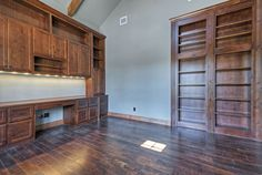 Study - office.  Built in cabinets made from clear alder wood , hidden bookcase.  Built by Olson Defendorf Custom Homes, Austin, Texas.