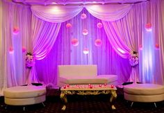 possible idea for reception backdrop? to have balls of fresh flowers hanging down??