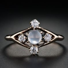 Moonstone and diamond ring. This is probably one of the most beautiful and unique engagement rings that I've seen. Love the moonstone.