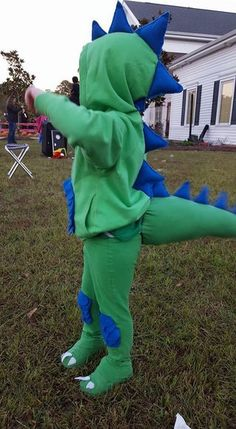 : This is a dinosaur costume I made for my 3 year old for Halloween.Materials-Hoddie-matching yard of matching color sheets of your choice color sheet of white roll of 1 inch wide elastic-A sewing needle- spools of . Toddler Dinosaur Costume, Toddler Boy Costumes, T Rex Costume, Dinosaur Costumes For Kids, Old Halloween Costumes, Halloween Kids, Halloween 2020, Costume Dinosaure, Family Costumes