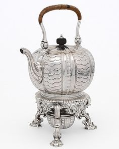 Kettle by Paul de Lamerie, 1730. The kettle became a standard item in the silver tea service around 1710. The vertical ribs of this kettle and its dolphin-mask feet were inspired by early 17th century Dutch silver, which imitated natural forms. The Victoria & Albert Museum.