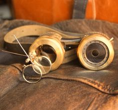 IRIS APERTURE goggles Brown and brass with one iris (left) and magnifier stem (right). $380.00, via Etsy.