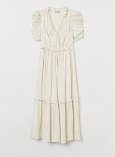 This beautiful ivory dress features a sweet ruched sleeve, ruffled neckline and tiered skirt, all the romantic elements in one beautiful dress. It's available in the client wardrobe in a size medium. Corsage, Satin Dresses, Dresses With Sleeves, Calf Length Dress, Fashion Company, Mannequin, Lady, Ruffle Trim, Style Guides