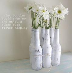 Painted beer bottle flower display, love this.. always plenty of beer bottles thrown out in our house!