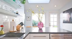 Subway Tile paired with Caesarstone Raven countertops.