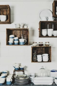 Super affordable way to add kitchen shelves using old crates. great storage and organization tip for a pantry.