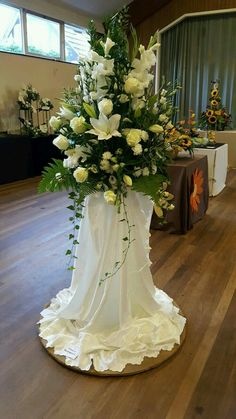 A beautiful standing Alter Arrangement with satin material gracefully draping down sides to pool at the bottom. Use alone or in pairs. Church Flowers, Altar Flowers, Funeral Flowers, Flower Arrangements For Weddings, Floral Centerpieces, Bridal Flowers, Flower Decorations, Floral Arrangements, Wedding Centerpieces