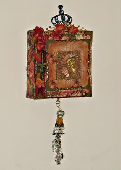 assemblage/collage - vintage and reproduction findings - altered canvas Available at https://www.zibbet.com/enchanted-revelries/shabby-boho-chic-assemblage-altered-canvas-handmade-ooak
