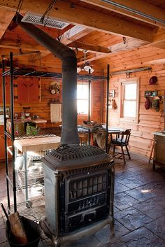 like the location of this stove...center of room so that its heat does not get pocketed up in a corner of the room...love...