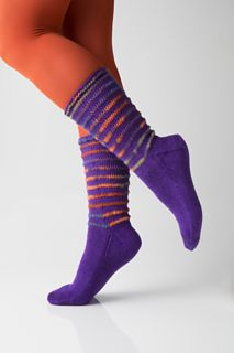 The elongated stitch (yarnovers worked on the first round and then dropped on the following round) gives this sock a simple but dramatic and elegant flair that makes it appropriate for anyone –especially in suitable colors, for a man's sock. An easy variation would be to work 3–4 rows of the elongated stitch separated by solid sections. Instead, work 3–4 elongated rows at the top (or around the ankle). Have fun!