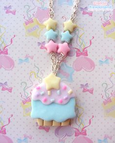 Delicious pastel cupcake necklace in blue.