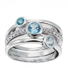 This set of three stackable silver rings can be worn all at once as a youthful statement piece, or separately as best-friend rings. Each ring features a bezel-set blue topaz, and one boasts a band set with a dozen white topaz accents.  15 Round Brilliant white and blue lab-created topazes Sterling Silver Product Model: LRRHXX0042XXXMLTZ0000XX0SSXX
