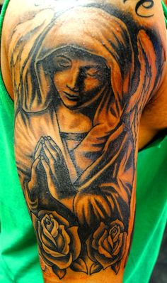 rose-flowers-and-praying-angel-tattoo-on-half-sleeve