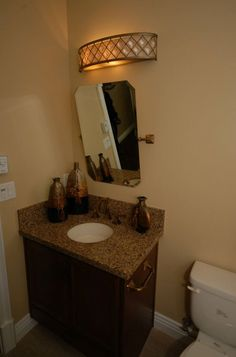 Jack Jill Bathroom Starmark Cherry Cabinets With Java Stain - Bathroom remodel bakersfield