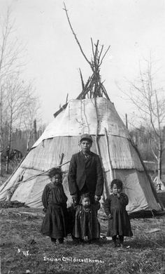 Four Indian children posing in front of a tipi on a Menominee Indian reservation.   Photo by Arthur J. Kingsbury, Antigo, Wisconsin.  Wisconsin Historical Society Archives
