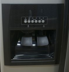 Remove hard water stains from refrigerator water dispenser.