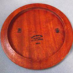 Wood disc golf disc.