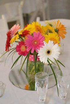 Gerbera daisies are a perfect centerpiece for an informal wedding