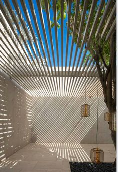 outdoor sun shade with light and airy wood slat pergola