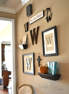 I like the mini shelf with figurine and/or potentially a small initial (Monogram-Gallery-Wall)