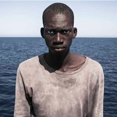 Portrait of Humanity: Amadou Sumaila by Cesar Dezfuli Mediterranean Sea, Libya 'Amadou, a young Malian, moments after he and 117 fellow travellers were rescued from the sea. The boat he was on had only departed Libya a short while earlier. Photography Exhibition, Photography Gallery, Color Photography, Amazing Photography, Portrait Photography, Langston Hughes, International Photography Awards, British Journal Of Photography, National Portrait Gallery