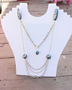 "This 34"" necklace is made with several styles of .925 silver layered chains, turquoise agate and silver, black and turquoise column and round beads with an S-clasp closure.    Note:  Some of the chains are upcycled from previously owned jewelry.  Upcycling is the process of converting old or di..."