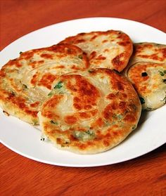 Chinese Scallion Pancakes--how to make. These are amazing! My mother-in-law makes them all the time.