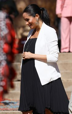 3dca55ee64ead Meghan Markle brings the glam in statement earrings and a chic white blazer