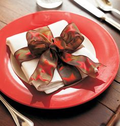 When setting the table for Christmas, incorporate whimsy and creativity. Mix and match dishes, add fun place cards, and use holiday-shaped cookie cutters or bright ribbons as napkin rings.