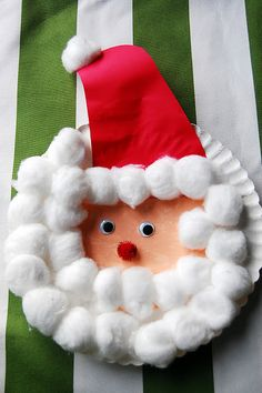 paper plate Santa kids craft using a paper plate, cotton balls, googly eyes and pom pom nose