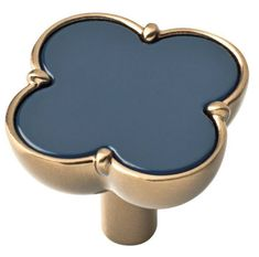 A Warm Champagne Bronze Finished Base  is completed with a classic navy insert in this unique upscale style knob. 1.33 inch DiameterBoth 1 in. and 1-5/8 in. fasteners are included for easy installation Liberty Hardware  Limited Lifetime Warranty