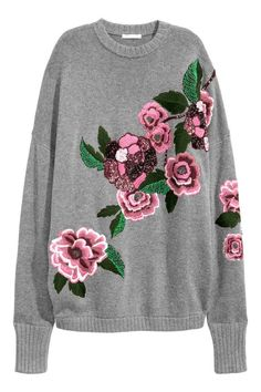 Embroidered jumper: Oversized jumper in a soft knit containing some wool with beaded and sequined embroidery, dropped shoulders and long sleeves with wide, ribbed cuffs.