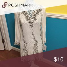 White dress with black detailing Super cute white tunic with black embroidering. Will look good with a slip or looks super cute as a swim cover up! Only worn once and in great condition! Dresses Mini