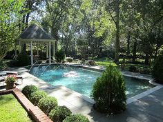 There is a beautiful elegance about this backyard pool and patio area in Louisiana.